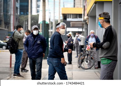 Lima, Peru - May 26 2020: Men in the streets wearing masks and face shields amid coronavirus outbreak in south America. COVID-19 times.