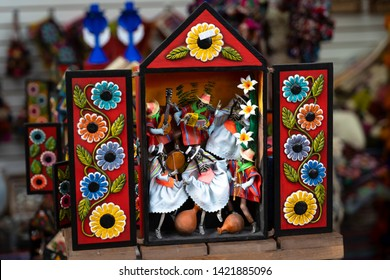 Lima, Peru - May 29 2019:  Colorful Peruvian artisanal Retablo for sale at street Indian market in Miraflores, Lima. A traditional devotional handcraft with iconography derived from traditional art.