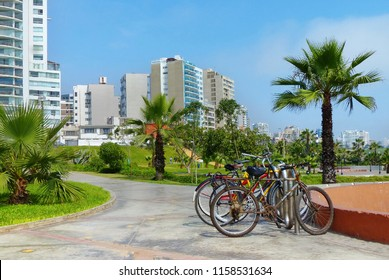 Lima, Peru. Modern buildings and park area in Miraflores district. Bicycles on the site for the rent