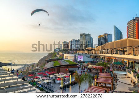 LIMA, PERU - NOVEMBER 26: A paraglider flies over the Larcomar in Lima, Peru on November 26, 2014