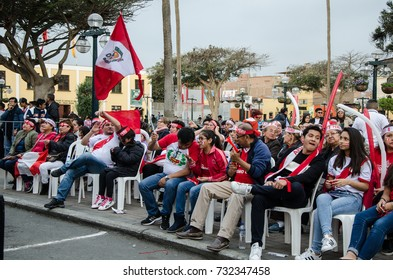 Lima, Peru - OCTOBER 10th 2017: Fanaticism in Peru (Peru vs Colombia) Russia 2018 . Peruvian fans waiting for the moment of the match in the Plaza de armas de Santiago de Surco - Lima - Perú