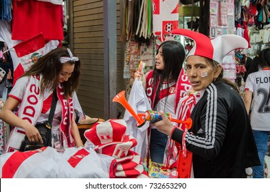 Lima, Peru - OCTOBER 10th 2017: Fanaticism in Peru (Peru vs Colombia) Russia 2018 . Three T-shirt sellers  at the Jorge Chavez Market in the district of Surco