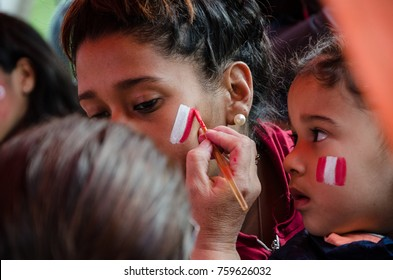 Lima, Peru - OCTOBER 10th 2017: Fanaticism in Peru (Peru vs Colombia) Russia 2018 . A fan painting his face with the colors of the Peruvian flag, preparing for the match