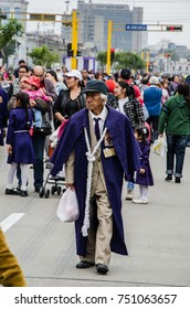 Lima, Peru - OCTOBER 28th 2017: Procession of the Lord of Miracles . An old man in purple attire, typical of the month of October of the Lord of Miracles