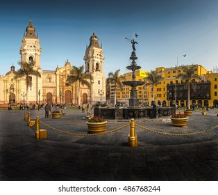 LIMA, PERU: Panoramic view of main square and cathedral church at sunset.