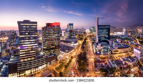 LIMA, PERU: Panoramic view of skyline in San Isidro district at blue time.