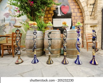 LIMASSOL, CYPRUS - 30 MAY 2014: Six shisha, aka nargile or hookah at a restaurant with fruit on top. A very middle eastern custom.