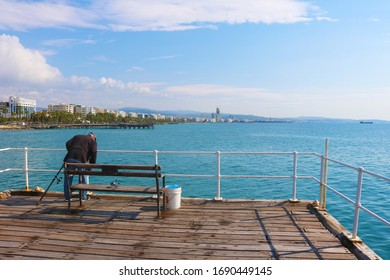 Limassol, Cyprus bridge on the marina man fishing