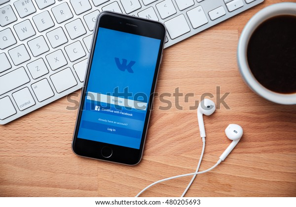 LIMASSOL, CYPRUS - DECEMBER 07, 2015. Iphone 6s screen with Vkontakte app lying on the wooden table. Vkontakte is a social network for quick and easy communication between people worldwide app