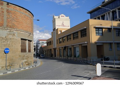 Limassol / Cyprus - December 19 2018: Limassol cityscape, Cyprus, area nearby marina, street, buildings, blue sky