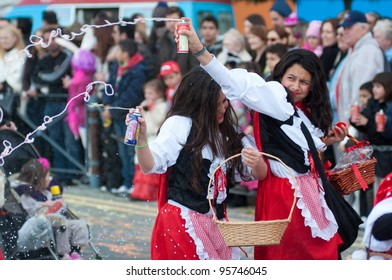 LIMASSOL, CYPRUS - FEBRUARY 18: Unidentified Carnival participants dressed like a red riding hoods during Children's Carnival Parade on February 18, 2012 in Limassol, Cyprus.