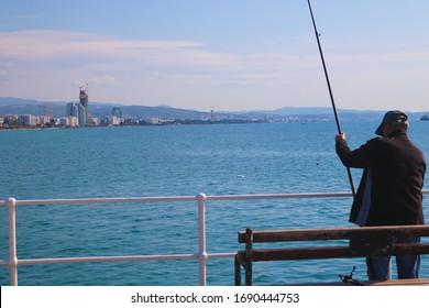 Limassol, Cyprus fishing on a bridge