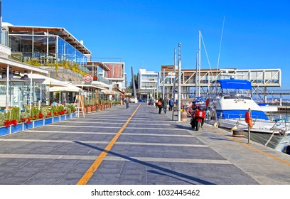 LIMASSOL, CYPRUS - JANUARY 9, 2018: View of the Limassol Old Port promenade with modern restaurants and yachts, Limassol Marina, Cyprus