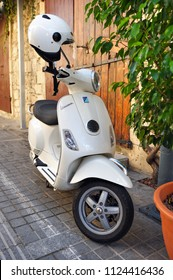 LIMASSOL, CYPRUS - November 04, 2017: White Vespa scooter parked on a city street