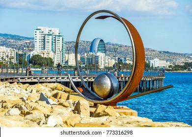 LIMASSOL, CYPRUS - November 22, 2017: Abstract sculpture on Molos Promenade, the main walking alley with trees and objects of contemporary art.