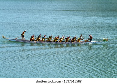 Limassol, Cyprus, October 19th, 2019: Mixed dragon boat team participating in the 11th International Dragon Boat Festival at Germasogeia reservoir