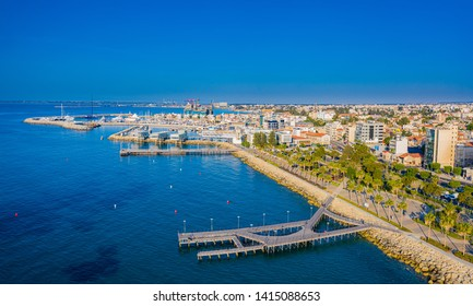 Limassol. Republic of Cyprus sea bay top view. Molos Limassol embankment. Quay piers lead to the sea. Berths for yachting. Mediterranean. The beaches in Cyprus. Travelling to Cyprus. Drone panorama.