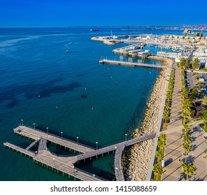 Limassol. Republic of Cyprus sea bay top panorama, Molos Limassol embankment. Quay pier leads to the sea from a height. Mediterranean. The beaches in Cyprus. Travelling to Cyprus. Port in Limassol
