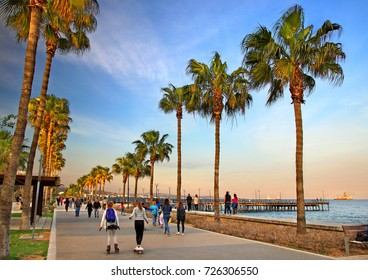 LIMASSOL TOWN, CYPRUS- April 10, 2017. Evening walk at the promenade next to the sculpture park, Limassol (Lemessos), Cyprus