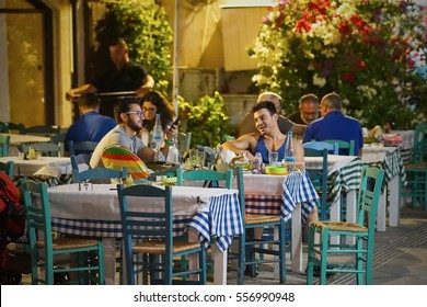 LIMASSOL/CYPRUS - SEPTEMBER 24, 2016: People sitting and having dinner at the traditional taverna in Limassol, Cyprus