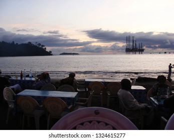 Limbe / Cameroon - September 2009: People sitting in a restaurant at the beach in Limbe.