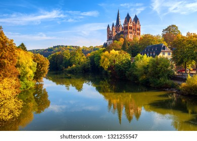 Limburg an der Lahn town, Germany, view of the catholic cathedral reflecting in Lahn river in autumn