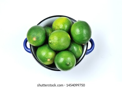 Lime Citrus Fruits in a bowl over white background