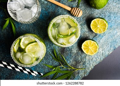 Lime cocktails with marijuana on stone table top view
