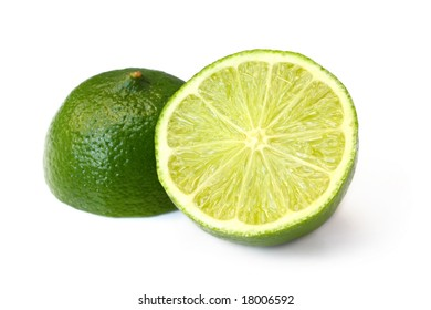 Lime, cut in half, isolated on white with natural shadow.