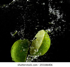 Lime falling in water, lime in the fall, collision with lime water (on a black background)