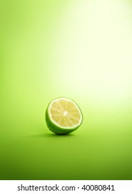 A lime fruit on a green background