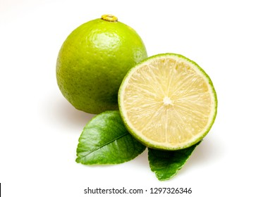 Lime fruits and piece with leaves isolated on white background.