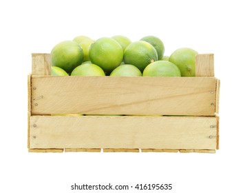 Lime fruits in wooden crate isolated on white background
