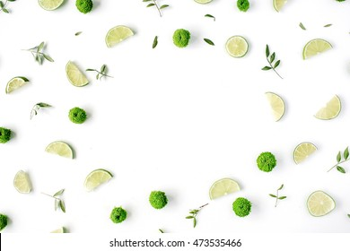 lime and green branches frame on white background. flat lay, top view