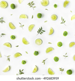 lime and green branches pattern on white background. flat lay, top view