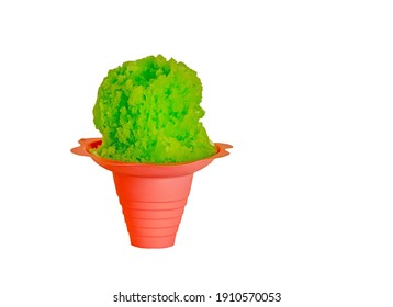 Lime green Hawaiian style shave ice, shaved ice or a snow cone in a red or pink flower shaped cup on a white background with copy space