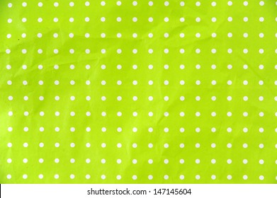 lime green paper with white dots as background