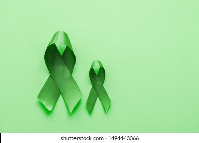 Lime Green Ribbons on green background, Mental health awareness and Lymphoma Awareness, World Mental Health Day