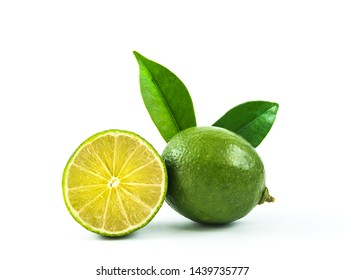 Lime and half lime with leaves isolated on white background