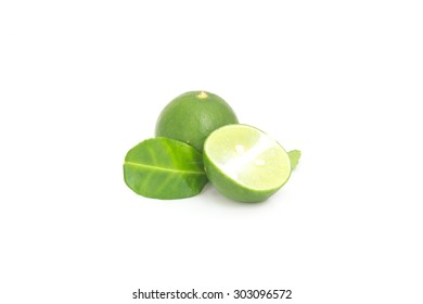 Lime with half and leaves isolated on white background