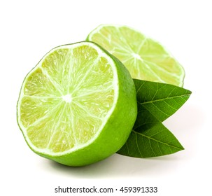 Lime halves with leaf isolated on white background