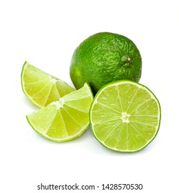 Lime isolated on white background. Whole and half with slice of fresh green limes