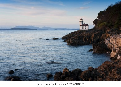 Lime Kiln Lighthouse. Situated in the northwest corner of Washington State, the San Juan Islands are breathtaking gems on a gentle sea that attract numerous visitors and adventurers each summer.