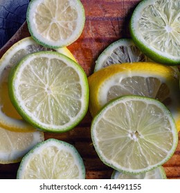 Lime and lemon on a wooden background