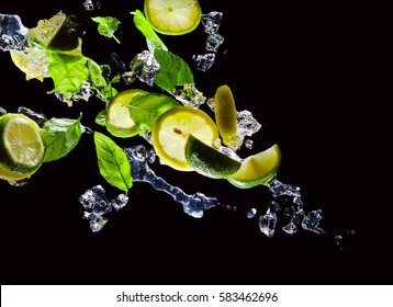 lime , lemon and  peppermint with ice on a black background