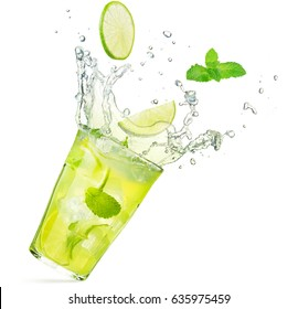 lime and mint falling into a splashing mojito cocktail
