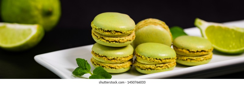 Lime and Mint Flavored Green Macaron. Panoramic image. Selective focus.