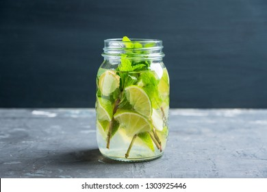 Lime, mint and ginger detox drink in jar. Selective focus.