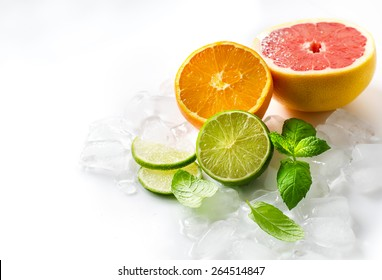 Lime, orange and grapefruit on white background selective focus