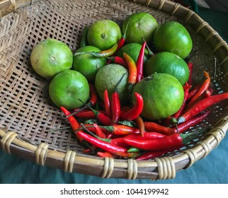 lime and red chilli in basket